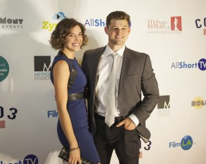 Actors, Kate Cobb and Kevin Bigley walk the red carpet on opening night.